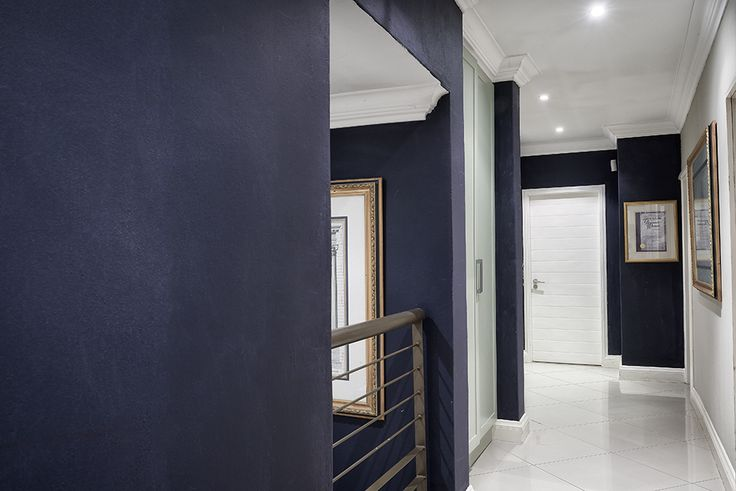 A sophisticated, stylish home in Johannesburg, showcasing a creative mixture of colours, styles and textures. Abundant use of original artworks and strong colour statements.