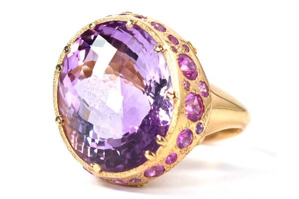 Perfect for Pantone's 2014 Color of the Year—Radiant Orchid: Ring in 18-karat pink gold featuring an amethyst center stone totaling 34.94 carats surrounded by 30 purple sapphires and 12 diamonds by Audrius Krulis, New York.