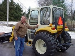 Tractor Cab - Homemade tractor cab intended for a Cub Cadet. Fabricated from steel tubing, angle iron, and sheetmetal.