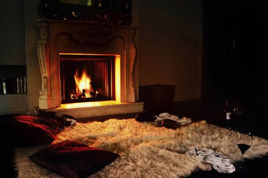 Fantasy set-up! Romantic fireplace and a white bearskin rug...upon which I would cuddle innocently. Of course. Ahem.
