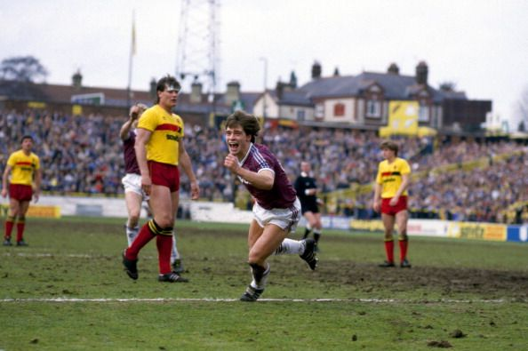 Tony Cottee celebrates clinching a win at a very different looking Vicarage Road on April 19, 1985. Getting to the away end always involved a unique walk round a massive bank of allotments. Strange what you remember.