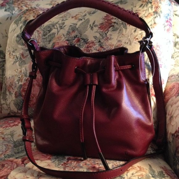 "Elliott Lucca  ""GiGi"" bag Elliott Lucca GiGi bag in Cabernet leather with optional shoulder strap. Drawstring and snap closure with zippered security pocket and pockets for phone/keys. 9""L X 8.5"" h X 5""w.  Cute bag! Elliott Lucca Bags Satchels"
