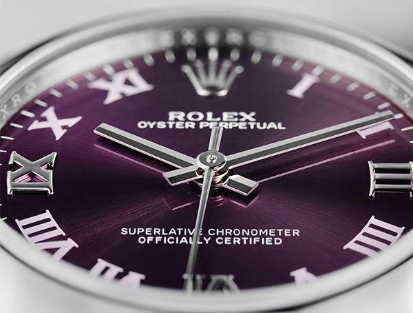 31mm Oyster Perpetual with red grape dial. The roman numerals add a touch of classic elegance.