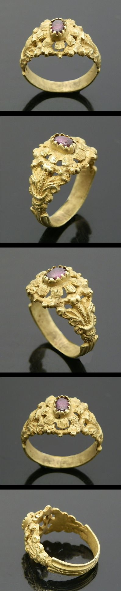 JACOBEAN PERIOD GOLD RING,  Description:  Information: Floral decoration to the shoulders and bezel with a raised central Amethyst, Date: C. Late 17th century