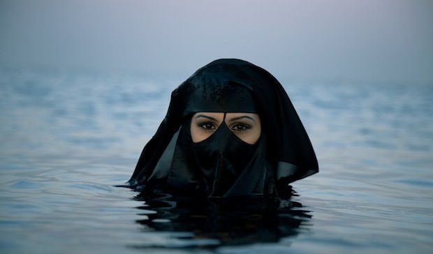 """Epic photo of the Muslim veil as an """"accentuation of beauty"""" Photographer Sebastian Farmborough went to Saudi Arabia and came across a Kodak moment he just couldn't afford to miss; a woman out at sea - covered in the Muslim veil. #niqab #niqabi #muslima #muslim #veiled #beauty #modesty"""
