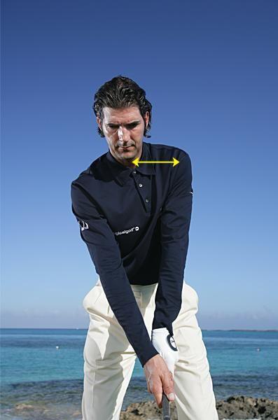 For longer golf shots and fewer slices, move your left shoulder