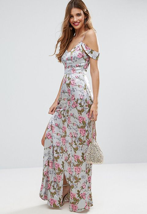 A cold-shoulder and discreet cut-out at the back moves this dreamy rose-print maxi away from classic bridesmaid territory. Throw in slinky satin fabric, thigh-high side-splits and you're on to a win