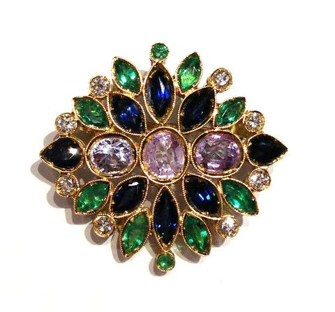 A Rose Window with Sapphires and Emeralds  This Brooch is realized with: Blue Sapphires, Emeralds, Diamonds brilliant cut, Zircons and Yellow Gold.  Emeralds 0,44 kt.  Blue Sapphires 0,90 kt.  Diamonds brilliant cut  0,40 kt.  F color  VVS 2  Yellow Gold 18 kt.  Total Weight 7,30 g.   2550$  Available only on Www.bangslove.com