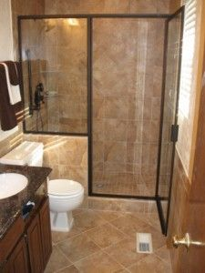 Here's a small bathroom but with a beautifully tiled shower, as well as floor and walls.