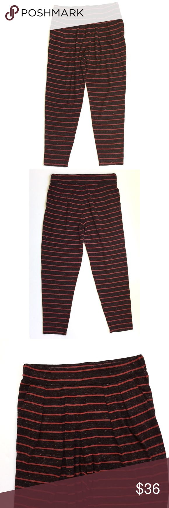 """Saint Grace striped lounge pants pockets Size Medium - Lightweight knit heathers burgundy striped pants. Super comfy. Slanted front pockets. Thick waistband. Legs taper a bit. Pleated front.  Waist laying flat measures 14.5"""" and has elastic. Rise 11"""". Inseam 27"""".  In excellent condition. Saint Grace Pants"""