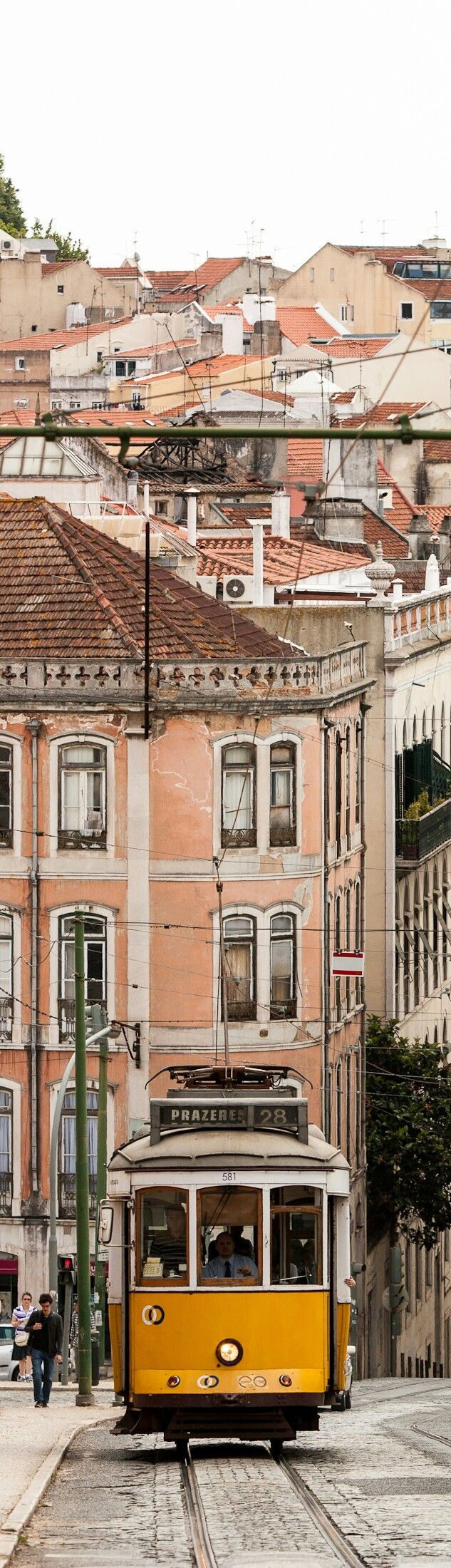 Climbing the hills in a tram - Lisbon #Portugal #adelinetravels