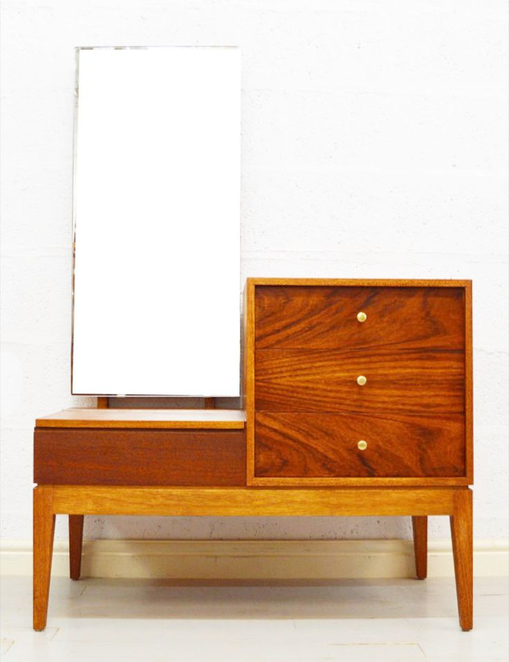 A unique rosewood and teak dressing table by Uniflex. Three spacious drawers to the right with small solid brass knobs and one lidded re-lined compartment to the left giving more storage space. There is some 'ghosting' from previous objects to the top of the drawers which we were unable to remove, apart from that this piece is in superb fully restored condition and has been finally finished with Danish oil.