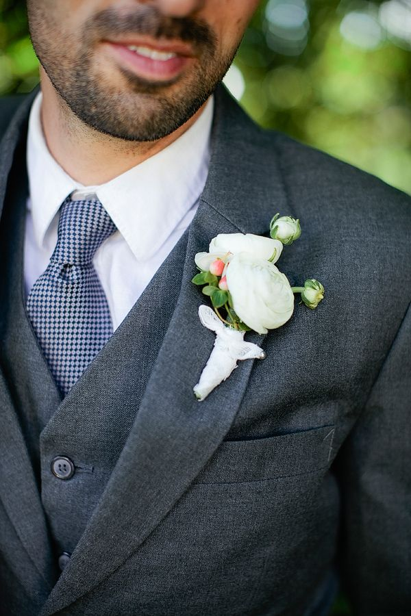 a simple but handsome white boutonniere #forthegroom #weddingboutonniere #dashing http://www.weddingchicks.com/2013/11/01/portland-backyard-wedding/