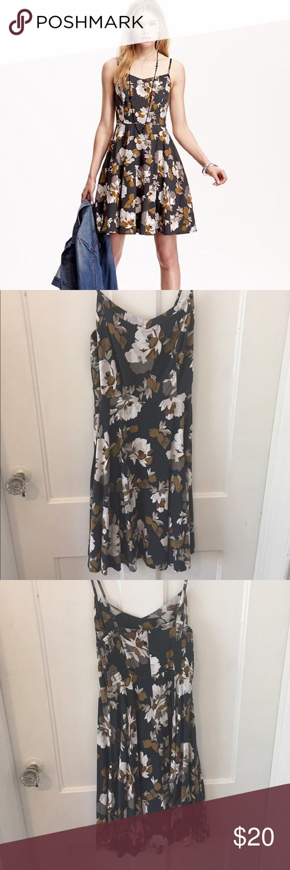 Old Navy Floral Cami Dress Cute cami dress from Old Navy in dark blue, gray, and camel floral. Stretchy panels in bodice and adjustable straps. 100% Rayon. Excellent used condition, worn and washed only a few times! Old Navy Dresses