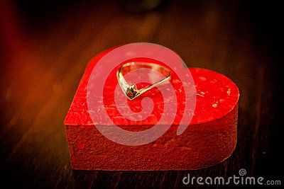 An engagement ring on top of a red heart. #stockphoto #valentinesday