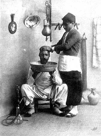 (presumably) A barbershop in old Damascus, around 1900