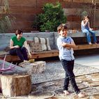 "The first thing landscape designer Laura Cooper asked Devis and Purdy was to recall childhood gardens and outdoor play. In that spirit, she designed their backyard, integrating the high ground with the low just outside the ""kids' wing."" The resulting series of outdoor rooms on this quarter-acre is full of memory and play.  Photo by Lisa Romerein."