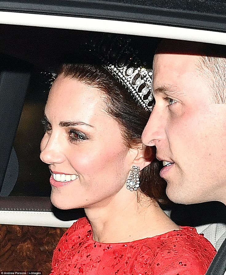 Kate (pictured this evening) was spotted en route to the same reception in the diamond and pearl Cambridge Lover's Knot tiara