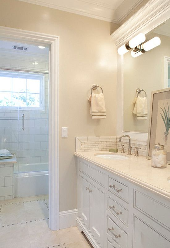 Wall paint color is Berber 955 by Benjamin Moore. Trims and Cabinets are Cotton Balls OC-122 by Benjamin Moore in semi-gloss.