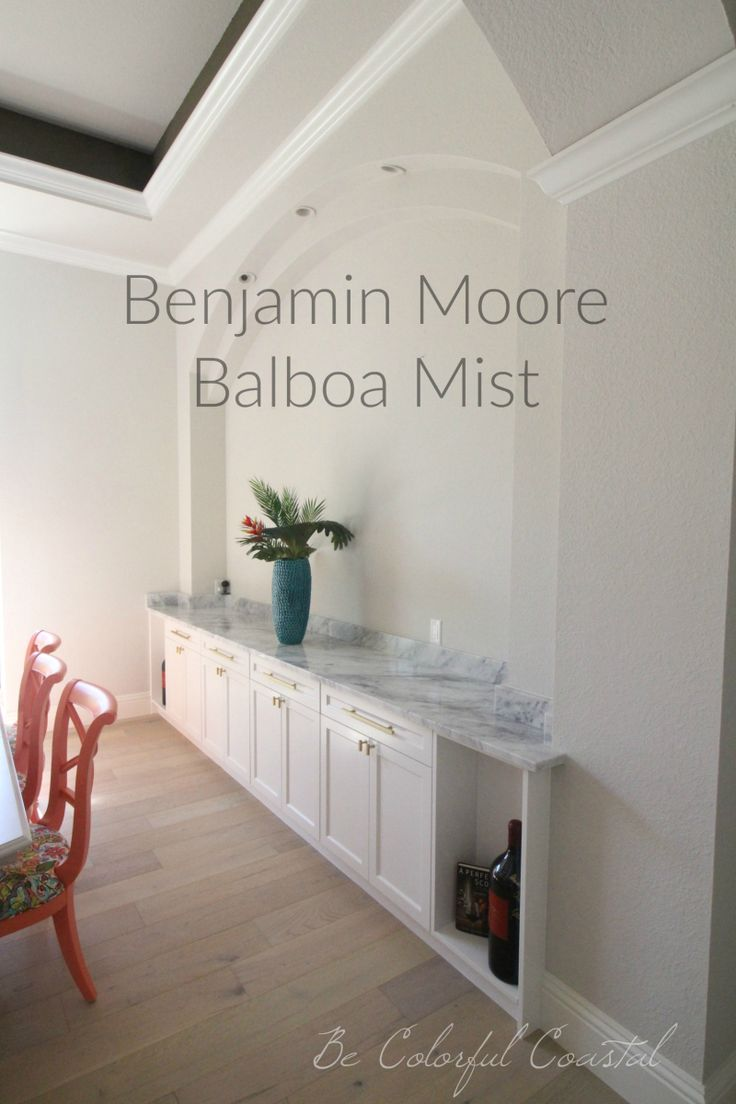One fabulous shade of gray Benjamin Moore Balboa Mist wall color with marble buffet  House in
