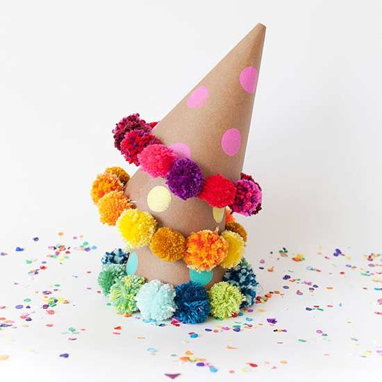 Your ticket under the big top? These darling carnival hats from Tell Love and Party. Forget no frills by dotting the hats with acrylic paint and rimming with pom-poms.