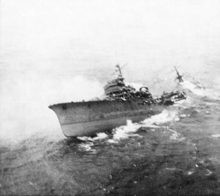 Japanese cruiser Kashii sinking by the stern after being attacked by United States carrier aircraft off the coast of French Indochina M..