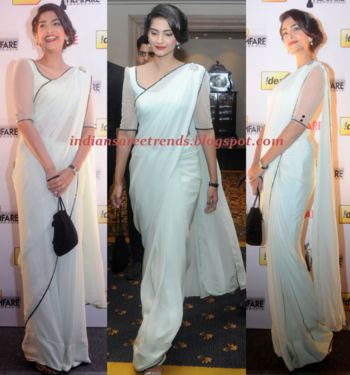 Sonam kapoor in plain white pure chiffon saree with transparent sleeves