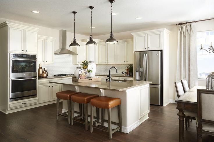 Warm, inviting white kitchen in Aurora, Colorado. | Arlington model home | Richmond American Homes