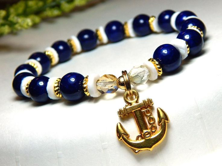 Blue and Gold Nautical Bracelet with an Anchor Charm and Shell Beads