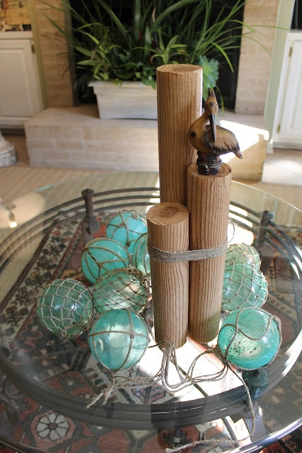 These decorative Nautical Pilings could be made using wood rounds from a home store.
