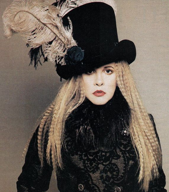 Stevie Nicks in a feather decorated top hat. This photo is a grand mixture of 70s Bohemian, goth, luxury and I would even say a touch of Marie Antoinette.