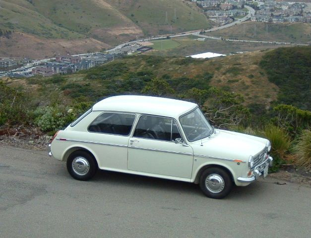 Austin America 1969- Kit's Car when I met her in 1971.  Her's was British Racing Green. Cute car.