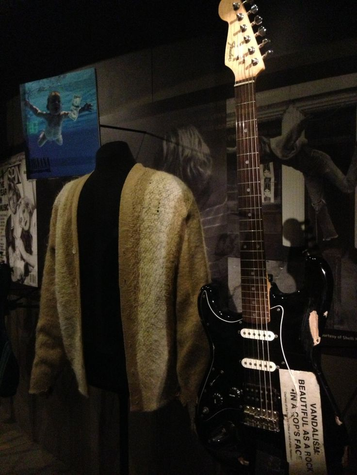 "One of Kurt Cobain's guitars on display at the EMP in Seattle. ""Vandalism: As Beautiful as a Rock in a Cop's Face""."