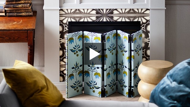 DIY Fireplace Screen | House & Home  to cover the bright brass surround without removing it.