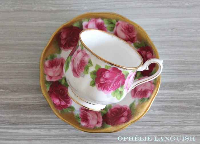 Stunning shabby chic tea cup and saucer featuring a light and dark rose motif against a white background. Elegant gold trim and scalloped edges in the Hampton style. Footed tea cup. A must have for any shabby chic tea cup collector!