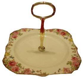 Square, single tiered handled cake plate. Non-original item.