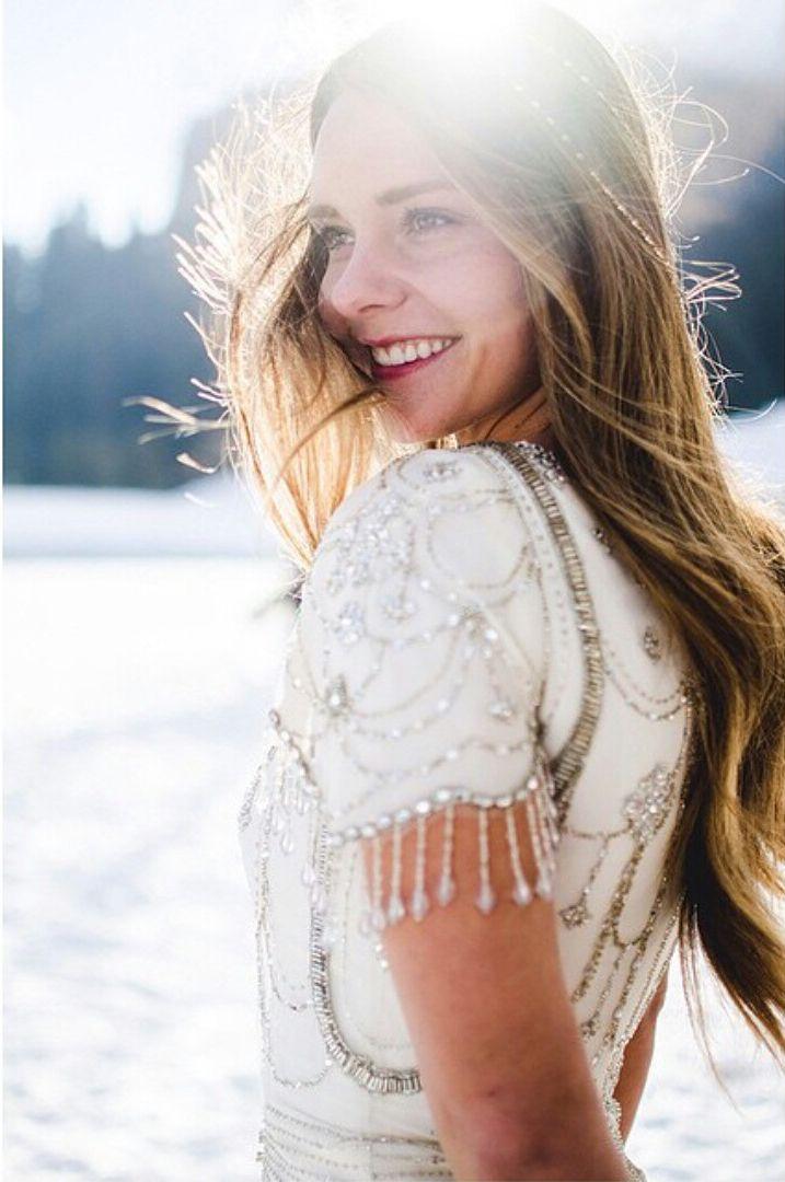 Beaded sleeve modest wedding dress with fluid skirt