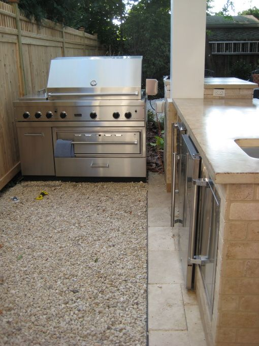 Small outdoor kitchen under patio outdoor kitchen on for Small backyard outdoor kitchen