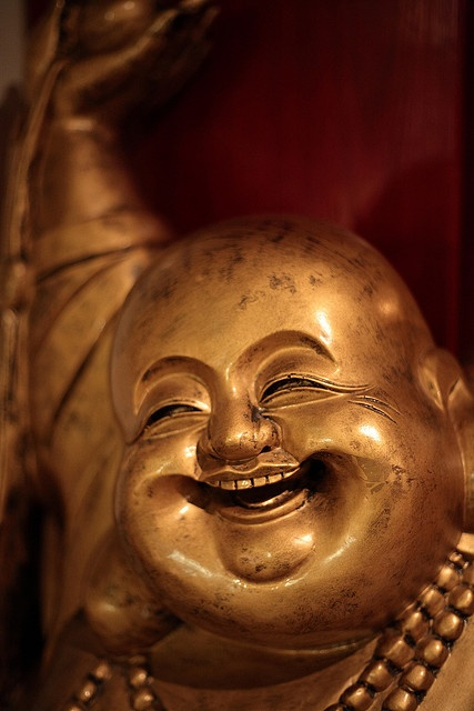Laughing Buddha at Chinese Restaurant by Petteri Sulonen, via Flickr