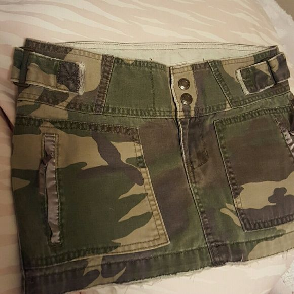 Abercrombie camouflage jean shorts Hip hugger mini, adjustable velcro cinch straps on waist, wide band, satin trim zip pockets, red star pocket stencil, like new. Abercrombie & Fitch Skirts Mini