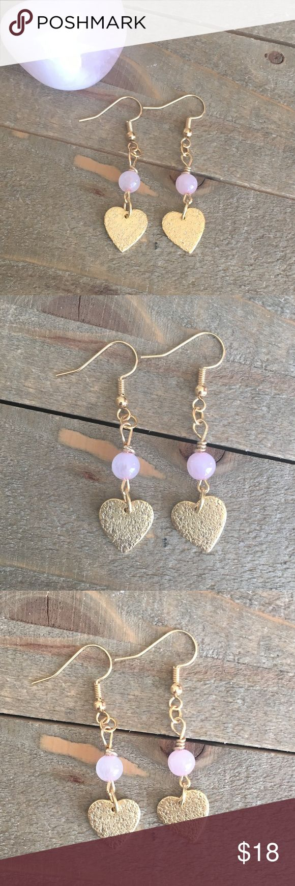 Rose Quartz Heart Earrings I designed and made these natural Rose Quartz heart earrings to bring love, kindness and friendship to the wearer. They feature 10K gold plate hearts and nickel free ear wires. This wonderful stone has several healing properties that are listed in the photos above.  Please Note: The use of gemstones is not meant as a substitute for medical or psychological diagnosis and treatment  Always made with love, light and positive energy! Handmade Jewelry Earrings