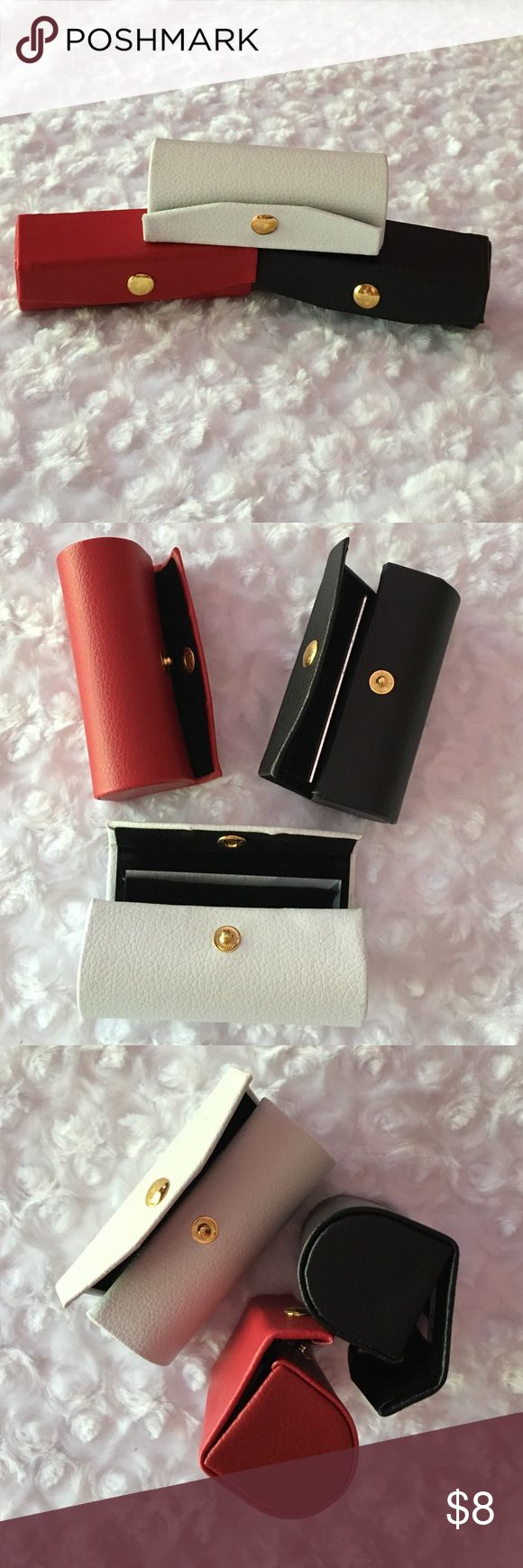 LEATHER LIPSTICK CASES Genuine leather lipstick cases with Mirror. Black. Red. White. Indicate which color. Stay Classy my friends. -No trades. Makeup Brushes & Tools