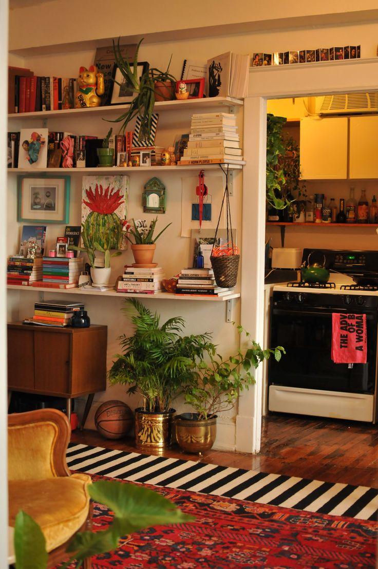 Layered rugs, stylized shelves