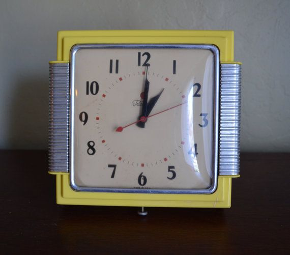 Vintage Telechron Wall Clock Yellow with Silver by UpswingVintage