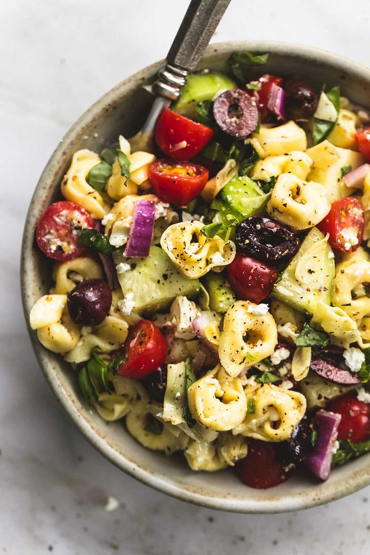 Quick and easy Greek Tortellini Pasta Salad with zesty Greek lemon dressing, fresh veggies, and hearty tortellini pasta. | lecremedelacrumb.com