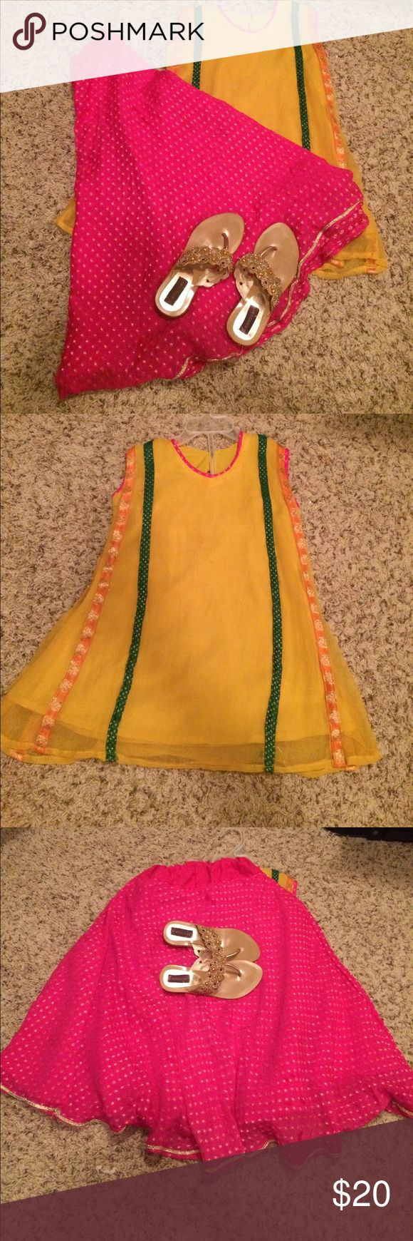 Two piece lehnga and kurti. Lehnga and kurti for girls ages 4-5 years old. Yellow, green and orange kurti with pink and gold lehnga. Used but it is in good condition. Other