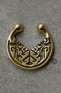 This ornate gold or silver septum clip.   16 Fake Body Piercings Your Parents Won't Even Mind