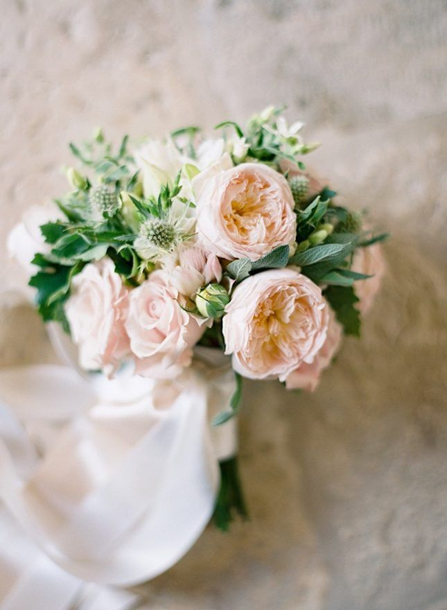 """Do you love lush, romantic peonies? Garden roses — also known as """"vintage roses"""" or """"cabbage roses"""" — are going to be your new BFFs! They look very similar, and won't cost you $200+ for a bouquet. This type of flower also has a longer growing season than peonies."""