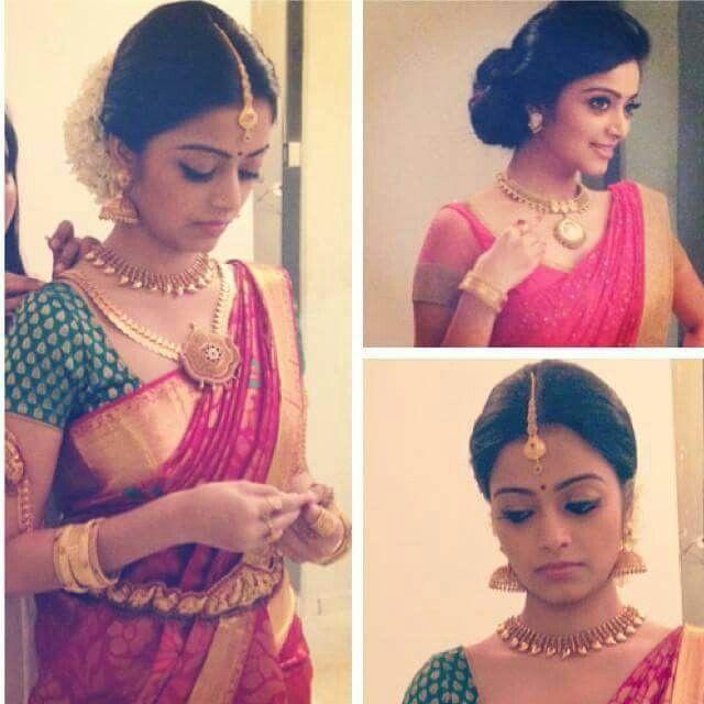 South Indian bride. Temple jewelry.Red Silk kanchipuram sari.Braid with fresh flowers. Tamil bride. Telugu bride. Kannada bride. Hindu bride. Malayalee bride.