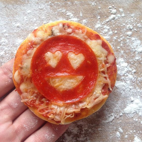 Mini pizza bagels made into an emoji, super easy if you have tiny cutters